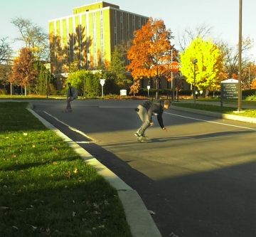 Warren and Klinges skateboard and longboard down Burrowes St. on West Campus. Photo by Sara Isenberg