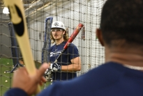 Penn State outfielder Keith Leavitt watches assistant coach Andre Butler critique his batting technique during batting practice in the batting cage at Medlar Field in State College Nov. 10, 2015.