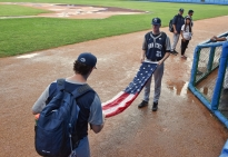 Penn State baseball players Nick Hedge, left, and Schuyler Bates fold the United States flag after their game against Cuba's Industriales was postponed due to rain at the Latin American Stadium in Havana, Cuba, on Sunday Nov. 22, 2015.