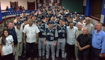 Penn State baseball officials, coaches and team members pose for a photo with Cuban baseball officials after a press conference with members of the Cuban Ministry of Sport in the Latin American Stadium in Havana.