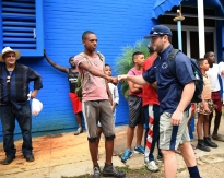 Penn State outfielder James Coates is greeted by Cuban youth outside the Latin America Stadium before the team's game against the Industriales in Havana, Cuba.