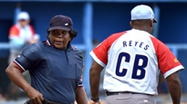Umpire Janet Moreno Mendinueta walks by the Ciego De Avila batboy between plays during the Penn State game against Ciego De Avila at Latin American Stadium in Havana, Cuba on Wednesday, Nov. 25, 2015. Photo by Kelsie Netzer