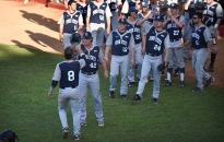 Teammates congratulate Christian Helsel (8) after hitting a home run at Nelson Fernandez Stadium in San Jose de las Lajas, Cuba Nov. 27, 2015. Penn State beat Mayabeque 9-3. Photo by Cameron Hart