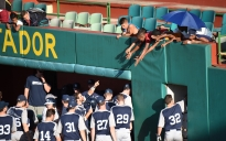 Redshirt junior Christian Helsel (8) points to Cuban fans after hitting a home run at Nelson Fernandez Stadium in San Jose de las Lajas, Cuba Nov. 27, 2015. Penn State defeated Mayabeque 9-3. Photo by Cameron Hart