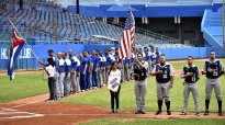 Penn State baseball team members participate in a pregame flag ceremony with Cuba's Industriales before competing in the Latin American Stadium in Havana, Cuba on Monday, Nov. 23, 2015. The Industrials defeated Penn State 2-1.