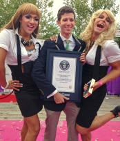 Alex Angert poses for pictures at the world's largest gathering of people dressed as drag queen Madonnas.