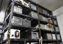 In a city where cemetery space is rare and expensive, the remains of the dead are often stored in boxes which sit on shelves. These are at the First Cemetery of Athens, one of the country's largest.
