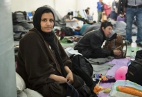 Fariba Shujaee, 25, of Afghanistan, sits on the floor of a ferry terminal at Piraeus port at then height of the refugee crisis in March, 2016. Shujaee is one of many pregnant women living in refugee camps throughout Athens.