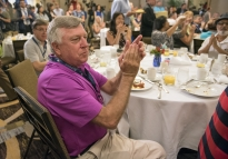 Mark Singel, former lieutenant governor of Pennsylvania applauds as the Pennsylvania delegation breakfast begins on Monday, July 25, 2016 during the Democratic National Convention in Philadelphia.