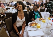Sharron Cooks, an at-large delegate for Hillary Clinton, left, and Valerie McDonald Roberts, a Hilary delegate, mingle with other Pennsylvania delegates and politicians at the first Pennsylvania delegation breakfast on July 25, 2016 in Philadelphia at the Democratic National Convention.