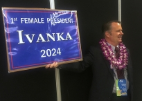 Retired Army colonel and consultant Allen Frenzel, an at-large delegate from Hawaii, displays his sign in support of Ivanka Trump as he waits to enter the Quicken Loans Arena in Cleveland for the Republican National Convention Tuesday, July 19, 2016. Photos by Waiss David Aramesh (Cell phone image)