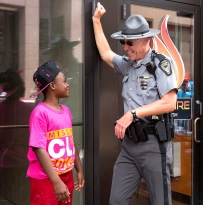 Chrishaun Butler, 11, of Cleveland, Ohio, jokes around with Ohio State Trooper Shane Zehnder, 46, on the fourth day of the Republican National Convention on Thursday, July 21, 2016. (Photo by Antonella Crescimbeni)