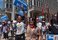 Hundreds of protestors gather to show their continued support for Bernie Sanders at a Bernie or Bust rally Tuesday, July 26, 2016 in Philadelphia during the Democratic National Convention. The rally was as much of a criticism of Hillary Clinton as it was in support of Sanders. (Photo by Gabrielle Mannino)