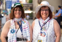Joanne Tosti-Vasey, from Bellefonte, PA, left, and her twin sister Linda Tosti-Lane, from Washington state, pose for a portrait in front of the Doubletree Hilton hotel after the Pennsylvania delegation breakfast in Philadelphia on Tuesday, July 26, 2016. Both sisters traveled to Philadelphia for the Democratic National Convention where Tosti-Vasey is a Bernie Sanders delegate and brought her sister, a Hillary Clinton supporter who missed being a delegate as well by one vote. (Photo by Antonella Crescimbeni)