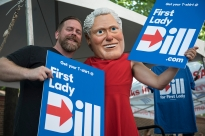 "Hundreds of people stopped to pose with the FirstLadyBill.com mascot during Philly Feast, a food truck festival in downtown Philadelphia on Monday July 25, 2016 during the Democratic National Convention. ""Using humor and heart to help make history,"" their website says. The Political Action Committee is challenging traditional gender roles in support of Hillary Clinton's goals as president. (Photo by Gabrielle Mannino)"