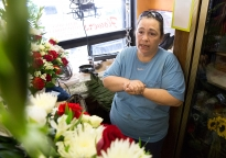 Cookie Cilberti, from Philadelphia, talks about the hardship she's been through as a small business owner in her shop, Betty Ann's flowers, during the Democratic National Convention in Philadelphia on Thursday, July 28, 2016. Cilberti works with her aunt in the flower shop and has been doing it for 26 years. (Photo by Antonella Crescimbeni)
