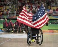 Men's wheelchair basketball co-captain Steve Serio celebrates Team USA's victory at mid court of the Rio Olympic Arena after the gold medal ceremony Friday, Sept. 17, 2016. USA defeated Spain 68-52 to win gold in the 2016 Paralympic Games.
