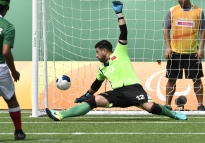 Rubicel de la Cruz of Mexico scores past Morocco's goalie Ayoub Serrakh on a penalty kick during their 2016 Paralympics Games football five-a-side match Thursday, Sept. 15, 2016 at the Olympic tennis Center in Rio de Janeiro. Mexico won the game 2-0. All of the players except the goalies are blindfolded.