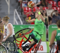 Brazil's Lia Martins takes a shot as she falls to the ground during Brazil's game against the U.S. in the women's wheelchair basketball quarter finals at the 2016 Paralympic Games in Rio de Janeiro, Brazil, on Tuesday, Sept. 13, 2016. (Antonella Crescimbeni/Penn State University via AP)