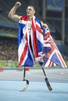 British runner Richard Whitehead celebrates his gold medal victory in the men's 200m final on Sunday Sept. 11, 2016 at the 2016 Paralympic Games at Olympic Stadium in Rio de Janeiro. The double amputee competes on customized carbon fiber blades.