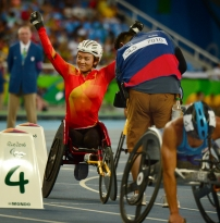 Zou Lihong, of China waves to the Olympic Stadium crowd after her bronze-medal finish in the women's 400 meters at the 2016 Paralympic Games at Olympic Stadium in Rio de Janeiro.