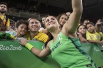 Brazil's Lia Martins takes a selfie with fans after Brazil's game against the U.S. in a women's wheelchair basketball quarterfinal game at the 2016 Paralympic Games in Rio de Janeiro, Brazil The U.S. defeated Brazil 66-35. The spirit of Brazil's fans, some of whom could not afford Summer Games, has lifted the Rio Paralympics. Tickets sales have now topped 2 million, organizers say.