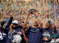 Penn State head coach James Franklin hoists the Big Ten Conference Football Championship trophy at Lucas Oil Stadium in Indianapolis, Ind. on Saturday, Dec. 3, 2016. Penn State defeated Wisconsin 38-31.