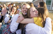 Dancers embrace as they walk through the human tunnel that leads to the Bryce Jordan Center and the start of THON on Friday, Feb. 17, 2017.