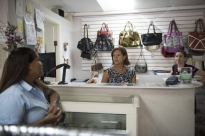 Rosalind Baitel (Roz) talks to her store's cashier and salesperson, Berta Ruiz, left, inside of her store, Promises Panama. Promises Consignment Boutique is the only consignment boutique in Panama dedicated to charity fundraising. Promises' mission is to raise money for local charities through the sale of high end gently used donated articles of men's and women's clothing and accessories. Promises raises money for over 40 charities and consults with groups on fund raising.