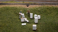 A group of beekeepers can be found on the layout.