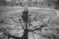 Reba stands under the shadow of an oak tree planted in memory of her husband Bill. The tree was planted in Spring Creek Park in the spring of 2002 after Bill passed away from heart disease.