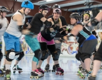 Melanie Lynch, also known as her skater name Pinky Balboa, plays as a blocker and tries to prevent a jammer from crossing during a scrimmage at Penn Skates academy on Monday, April 17, 2017. Players that wear black stars on their helmets are called jammers and their main goal is to pass blockers and are also the only ones that can score points. Blockers are the defensive players preventing the other teams jammer from scoring and clearing the way for their own jammer. Blockers can also switch and play on the offensive team.