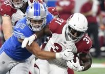 Detroit Lions defensive tackle Anthony Zettel (69) stops Arizona Cardinals running back David Johnson (31) during an NFL football game in Detroit, Sunday, Sept. 10, 2017. (AP Photo/Jose Juarez)