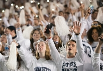 """Penn State fans sing """"Sweet Caroline"""" during the first half of a """"White Out"""" game against Michigan Saturday, Oct. 21, 2017. Penn State won 42-13."""