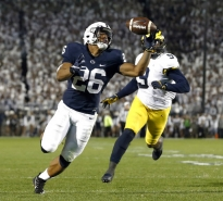 Penn State's Saquon Barkley (26) gains control of a pass and takes it in for a touchdown against Michigan during the second half of an NCAA college football game in State College, Pa., Saturday, Oct. 21, 2017. Penn State won 42-13. (AP Photo/Chris Knight)