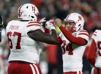 Nebraska place kicker Drew Brown (34) celebrates a field goal against Purdue with offensive lineman Jerald Foster (67) during the second half of an NCAA college football game in West Lafayette, Ind., Saturday, Oct. 28, 2017. (AP Photo/Michael Conroy)