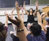 Van Kuren practices West African dance during a dance appreciation class at Penn State.