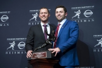 Oklahoma head football coach Lincoln Riley, left, stands with Oklahoma quarterback Baker Mayfield, winner of the Heisman Trophy, during a news conference Saturday, Dec. 9, 2017, in New York. (AP Photo/Craig Ruttle)