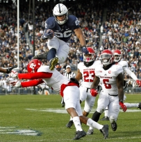 File-This Nov. 11, 2017, file photo shows Penn State's Saquon Barkley (26) hurdling Rutgers' Kiy Hester (2) during the second half of an NCAA college football game in State College, Pa. Barkley was selected to the AP All-America team announced Monday, Dec. 11, 2017.  (AP Photo/Chris Knight, File)