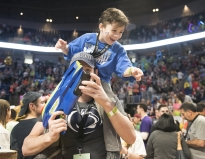Layn Berger, brother of THON child Romeo Berger, sits on the shoulders of Jackson Wagner during THON Saturday, Feb. 17, 2018.