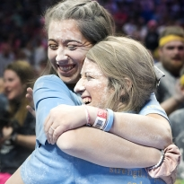 Maddy Hughes, left, and Cheyenne McIntyre, committee members from OPP, embrace during the Slides of Strength at THON 2018 early Sunday, Feb. 18, 2018.