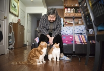 Meiying Dong, 94, came to the United States 21 years ago to care for her daughter and newborn grandsons. She now lives with family members and her cats in an apartment in Queens, New York.