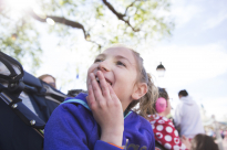 Camryn Shomo, 11, of State College, Pa. watches the Festival of Fantasy parade at Walt Disney World on Thursday, March 8, 2018.