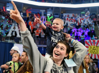 THON child Shiloh Crimmel, 2, from York, Pa., is carried across the main floor of the Bryce Jordan Center by family member, Mackenzie Cohen on Saturday Feb. 16, 2019.