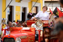 María Meléndez, the mayor of Ponce, Puerto Rico, laughs on the back of an antique firetruck during the Carnaval Ponceño parade in Ponce on Sunday, March 3, 2019.
