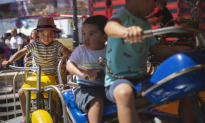 Children on the carnival rides in Ponce.