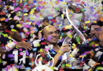 Penn State Head Football Coach James Franklin hoists the Cotton Bowl trophy after his team defeated Memphis 53-39 in the 84th Cotton Bowl Classic, at AT&T Stadium in Arlington, Tx. on Saturday, Dec. 28, 2019.