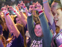 THON dancer Ellie Stewart, center, makes the Four Diamonds symbol during the My Hero Zero performance at THON on Saturday.