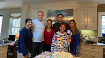 The Chumley/Gross Family: Angelia, Ken, Liz, Alexi, Melina, and Frances in front, celebrating Liz's birthday in quarantine.