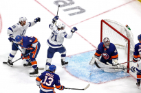 Anthony Cirelli, middle, scored the winning goal on Thursday, sending the Lightning to the Stanley Cup finals for the second time in six years.